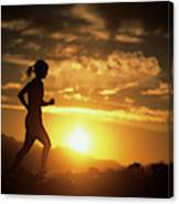 A Woman Jogs Under Sunset Canvas Print