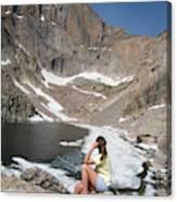 A Woman Looks Across A Partially Frozen Canvas Print