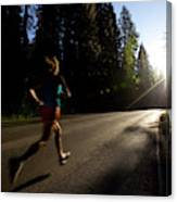 A Woman Running On A Country Road Canvas Print