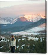 A Woman Stands Against A Snowy Mountain Canvas Print