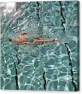 A Woman Swimming In A Pool Canvas Print
