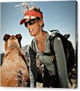 A Woman  Talks To Her Dog While Taking Canvas Print