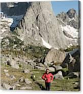 A Woman Trail Running In The Cirque Canvas Print