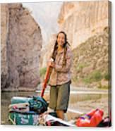 A Woman Unloads Gear From Her Canoe Canvas Print