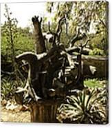 A Wooden Sculpture Inside A Garden Canvas Print