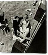 A Young Couple Lying On A Beach Canvas Print