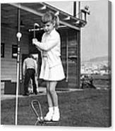 A Young Girl Hits A Golf Ball Canvas Print
