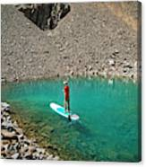 A Young Male Paddleboarding On A Small Canvas Print