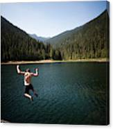 A Young Man Jumps From A Ledge Canvas Print