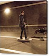 A Young Man On A Skateboard Is Pulled Canvas Print