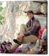 A Young Rock Climber Puts On A Climbing Canvas Print