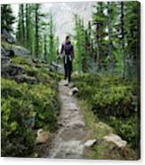 A Young Woman Walks Along An Sub-alpine Canvas Print