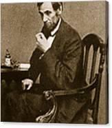 Abraham Lincoln Sitting At Desk Canvas Print