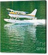 Aircraft Seaplane Taking Off On Calm Water Of Lake Canvas Print