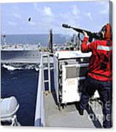 Airman Fires A Shot Line From Uss Canvas Print