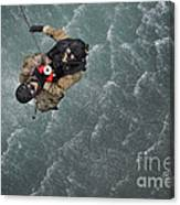 Airmen Are Hoisted Out Of The Water Canvas Print