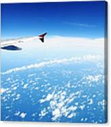 Airplane Wing Against Blue Sky Horizon Canvas Print