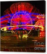 All The Rides Moving At Once Canvas Print