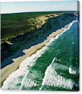 An Aerial View Of Waves Hitting Canvas Print