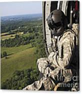 An Army Crew Chief Looks Out The Door Canvas Print