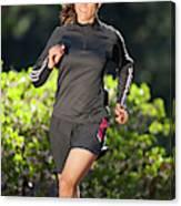 An Athletic Woman Trail Running Canvas Print