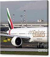 An Emirates Boeing 777 At Milano Canvas Print