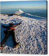 An Exhausted Climber Lies On The Summit Canvas Print