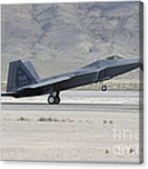 An F-22 Raptor Landing On The Runway Canvas Print