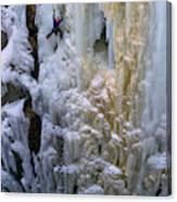 An Ice Climber Ascends A Frozen Canvas Print