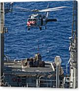 An Mh-60s Sea Hawk Delivers Supplies Canvas Print