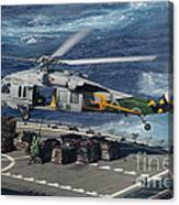 An Mh-60s Sea Hawk Helicopter Picks Canvas Print