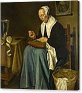 An Old Woman Seated Sewing Canvas Print