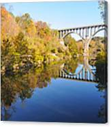 Arched Bridge Over Blue Water Canvas Print