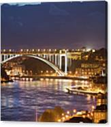 Arrabida Bridge At Night In Porto And Gaia Canvas Print