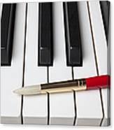 Artist Brush On Piano Keys Canvas Print