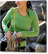Attractive Female Climber Adjusting Canvas Print