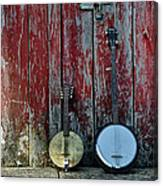 Banjos Against A Barn Door Canvas Print