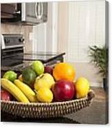 Basket Of Fresh Fruit In Modern Kitchen Canvas Print