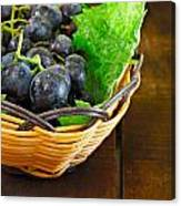 Basket Of Grapes On Rustic Wooden Table Canvas Print