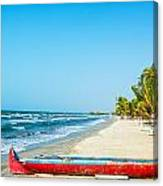 Beach And Red Canoe Canvas Print