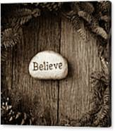 Believe In Text In The Center Of A Christmas Wreath Canvas Print