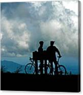 Bicyclists In The Clouds Canvas Print