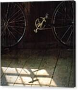 Bike Light And Shadow In Barn Canvas Print