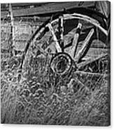 Black And White Photo Of An Old Broken Wheel Of A Farm Wagon Canvas Print