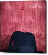 Black Hat On Red Velvet Chair Canvas Print