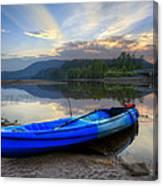 Blue Canoe At Sunset Canvas Print