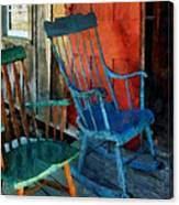 Blue Chair Against Red Door Canvas Print