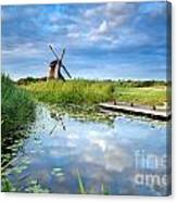 Blue Sky And Windmill Reflected In River Canvas Print