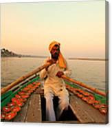 Boat Man On The Ganges River At Varanasi Canvas Print