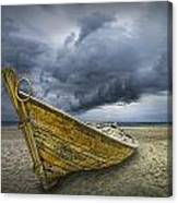 Boat On The Beach With Oncoming Storm Canvas Print